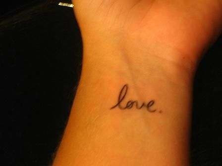 Black simple love tattoo on arm