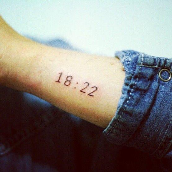 Black simple number tattoo on arm