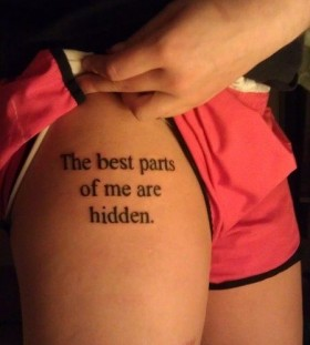 Black simple quote tattoo on leg