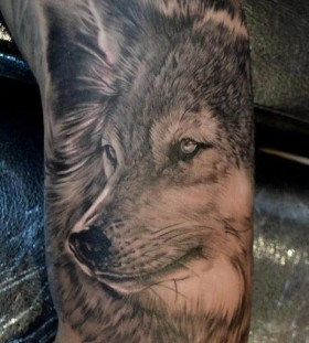Black simple wolf tattoo on arm
