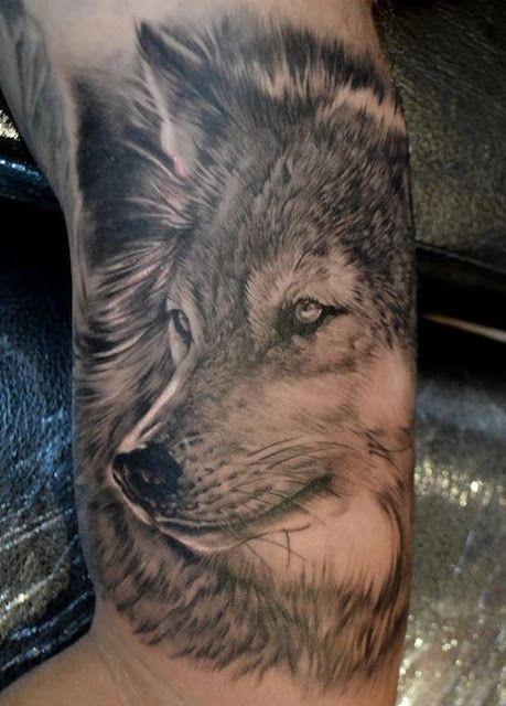 Black simple wolf tattoo on arm