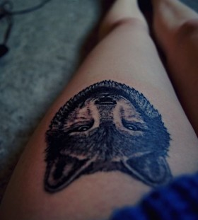Black simple wolf tattoo on leg