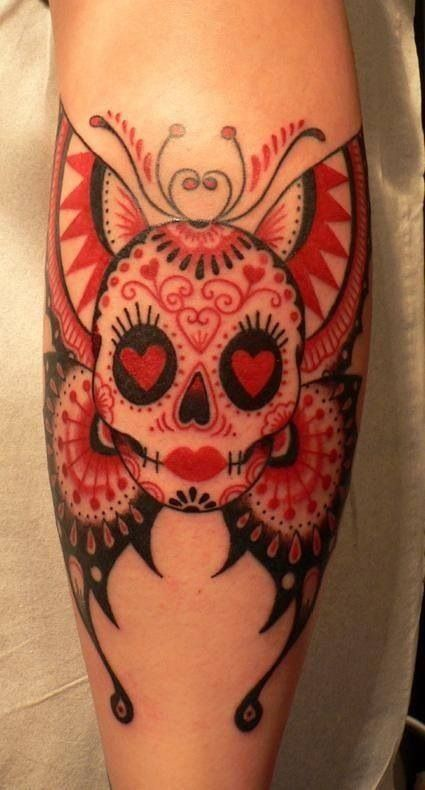 Black skull and red butterfly tattooo