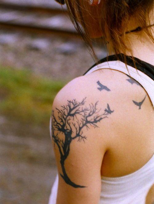 Black tree and bird tattoo on shoulder