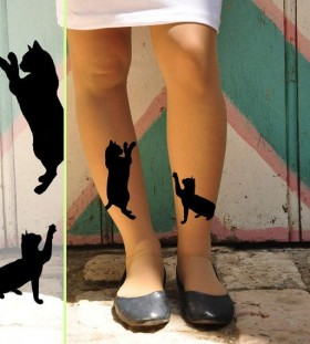 Black women cat tattoo on leg