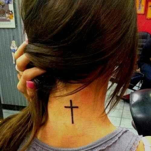 Black women's back cross tattoo
