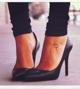 Black women's high-heels and heart tattoo