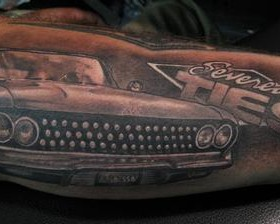 Black words and car tattoo on arm