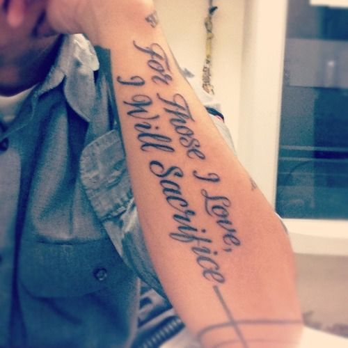 Black words quote tattoo on arm