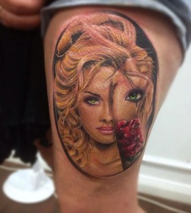 Blonde girl's face tattoo on arm
