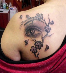 Blossom cherry eye tattoo on shoulder