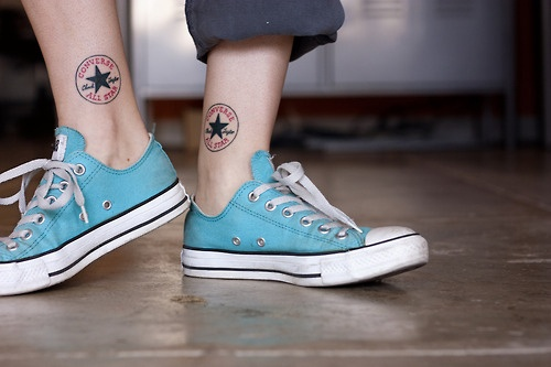 Blue and black tattoo with shoes