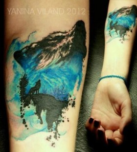 Blue and black wolf tattoo on arm