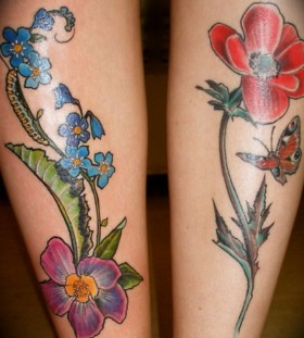 Blue and red poppy tattoo on leg
