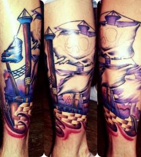 Blue and red ship tattoo on leg