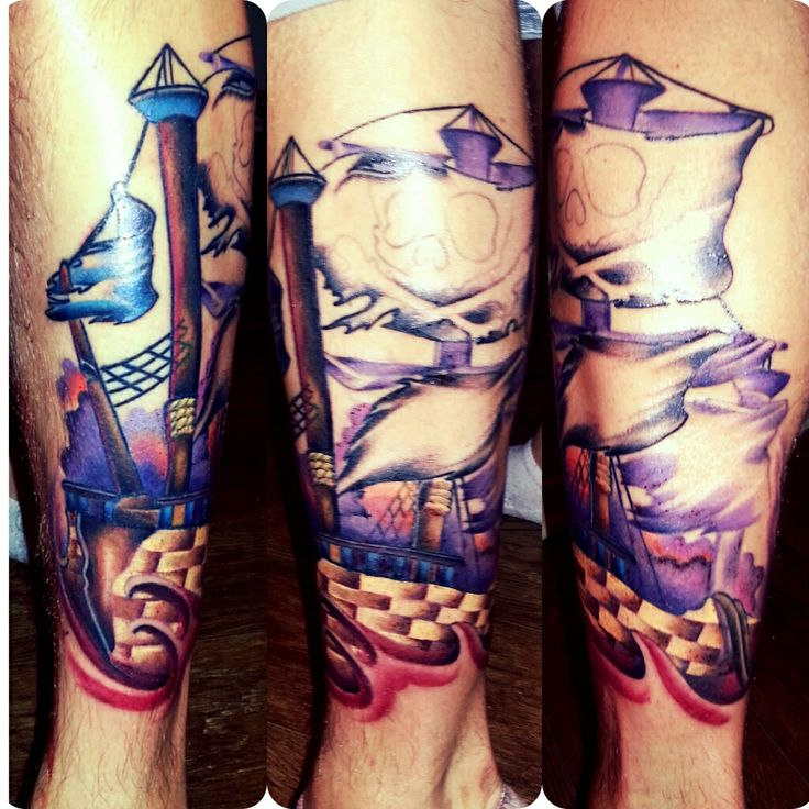 Blue and red ship tattoo on leg - | TattooMagz › Tattoo