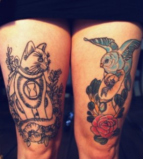 Blue bird and cat tattoo on leg