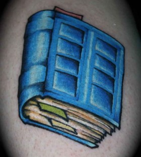 Blue cool book tattoo on arm