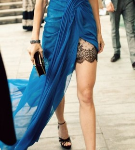 Blue dress and lace tattoo on leg