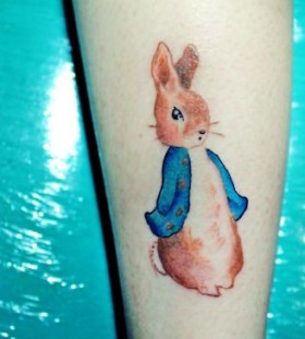 Blue jacket and lovely rabbit tattoo on arm