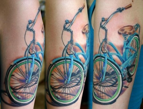 Blue lovely bicycle tattoo on arm