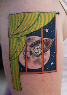 Blue star and window moon tattoo on shoulder