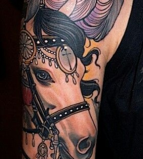 Bracelet and adorable horse tattoo on arm