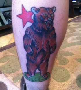 Brown bear and red star tattoo