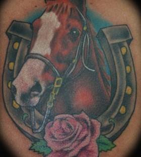 Brown horse with horse shoe tattoo