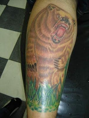 Brown lovely bear tattoo on arm