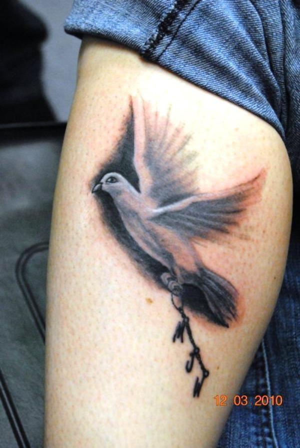 Brown lovely bird tattoo on leg