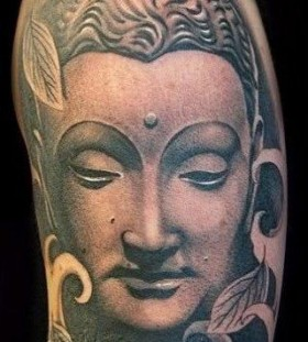 Buddha design face tattoo on arm
