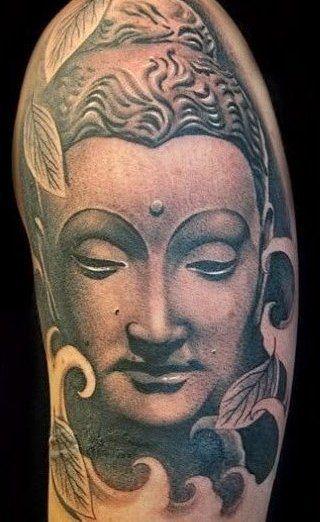Buddha design face tattoo on arm