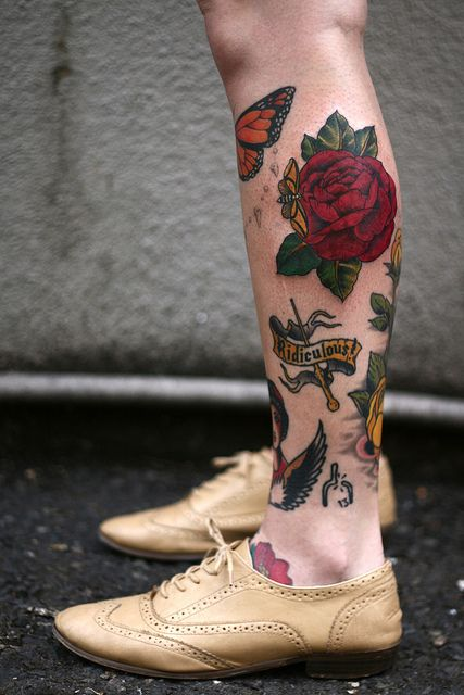 Butterflies and red rose tattoo on leg