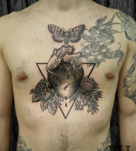 Butterfly and adorable flower tattoo on chest