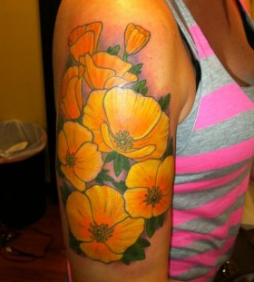 California style poppy tattoo on arm
