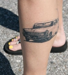 Chevy black car tattoo on leg