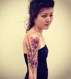 Chinese girl flower tattoo on hand