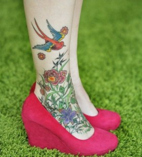 Colorful bird and flowers tattoo with shoes