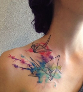 Colorful black origami tattoo on shoulder
