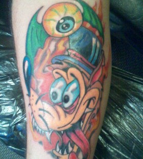 Colorful cartoon style wolf tattoo on leg