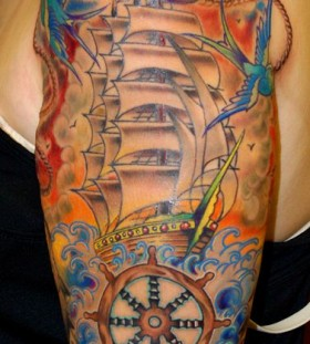 Colorful cute ship tattoo on arm