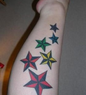 Colorful flowers star tattoo on arm
