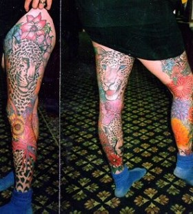 Colorful girl tiger tattoo on leg
