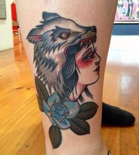 Colorful girl wolf tattoo on leg