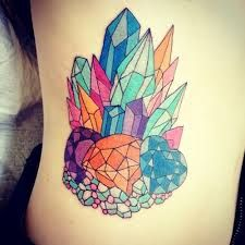 Colorful huge crystal tattoo on leg