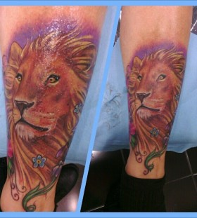 Colorful pretty lion tattoo on leg