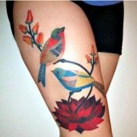 Colorful red bird tattoo on leg