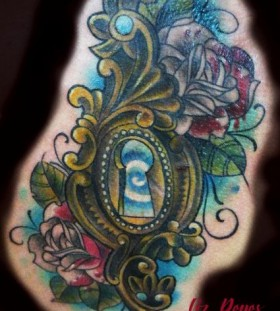 Colorful rose and keyhole tattoo