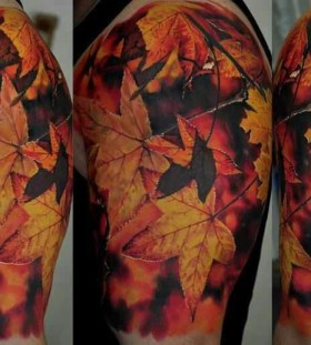 Colorful simple leafs tattoo by Dimitry Samohin